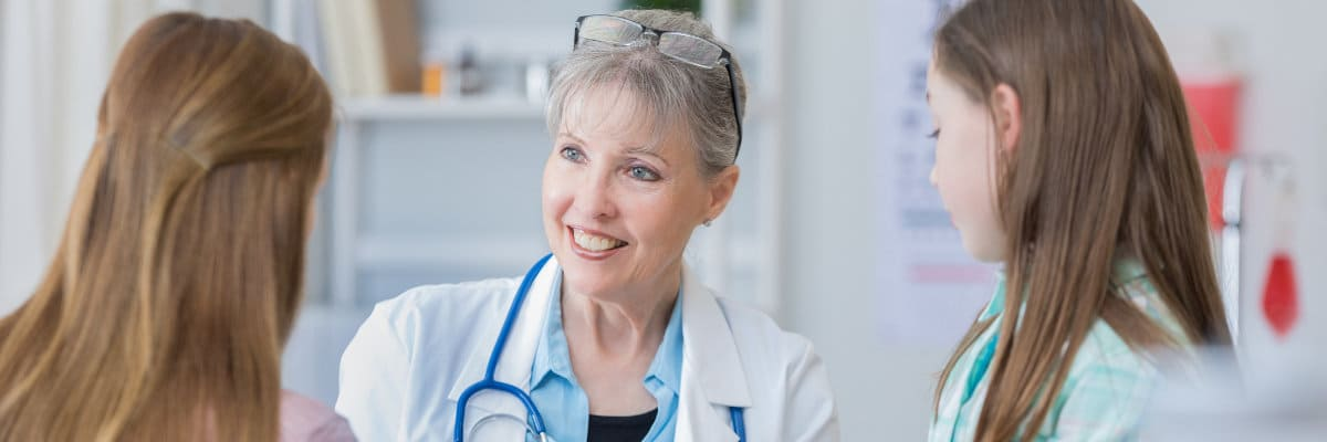 Image of doctor answering questions - stem cell treatment FAQ